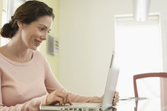 Beautiful Businesswoman Using Laptop In Office Stock Images