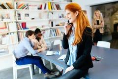 Beautiful businesswoman using phone Stock Photo