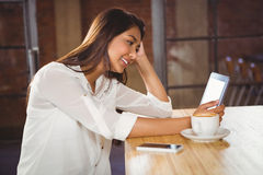 A beautiful businesswoman using a tablet Stock Photography