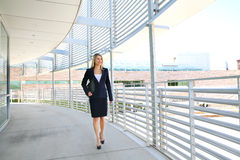 A beautiful businesswoman walking in a business building royalty free stock photos