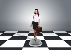 Beautiful businesswoman walking and holding Stock Photo