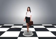 Beautiful businesswoman walking and holding Stock Photo