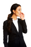 Beautiful businesswoman whispering to someone Stock Photos