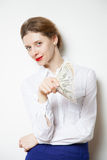 Beautiful businesswoman winking and holding dollars Royalty Free Stock Images