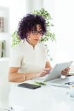 Beautiful businesswoman working with her digital tablet in the office. Stock Image