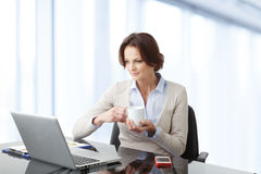 Beautiful businesswoman working on her laptop Royalty Free Stock Image