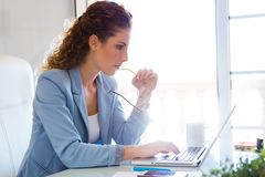 Beautiful businesswoman working with her laptop in the office. Stock Photography