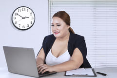 Beautiful businesswoman working on laptop Royalty Free Stock Photo