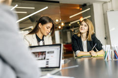 Beautiful businesswoman working in office stock image