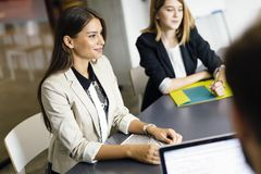 Beautiful businesswoman working in office stock images