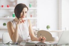Beautiful businesswoman working on project Stock Photo