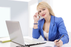 Beautiful businesswoman working sitting at her desk in the offic Stock Photo