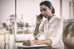 Beautiful businesswoman working sitting at her desk Royalty Free Stock Image
