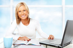 Beautiful businesswoman working or studying Stock Image
