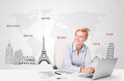 Beautiful businesswoman with world map and major landmarks of th Royalty Free Stock Photo