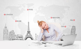 Beautiful businesswoman with world map and major landmarks of th Stock Photo