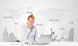 Beautiful businesswoman with world map and major landmarks of th Stock Images