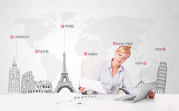 Beautiful businesswoman with world map and major landmarks of th Stock Photography