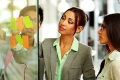 Beautiful businesswoman writes notes Royalty Free Stock Image