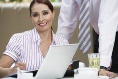 Beautiful Businesswoman Writing Notes royalty free stock photos
