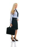 Beautiful businesswomen with briefcase. Isolated on white Royalty Free Stock Photography