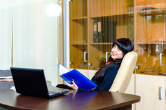 Beautiful businesswomen sitting at the table in the office Stock Photo