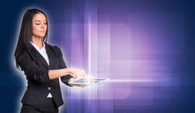 Beautiful businesswomen in suit using digital Royalty Free Stock Photography