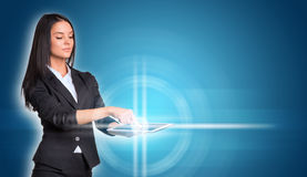 Beautiful businesswomen in suit using digital Royalty Free Stock Images