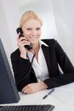 Beautiful businesswomen talking on the phone Stock Photography