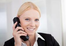 Beautiful businesswomen talking on the phone Royalty Free Stock Photo
