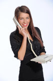 Beautiful businesswomen talking on the phone in the office Stock Photos