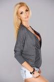 Beautiful busty blond woman Stock Photography