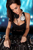 Beautiful busty DJ mixing sound Royalty Free Stock Images