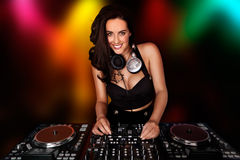 Beautiful busty DJ working at her deck Stock Images