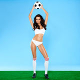 Beautiful busty woman soccer player in lingerie Stock Photo