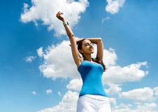 Beautiful busty young woman rejoicing in the sun Royalty Free Stock Photo