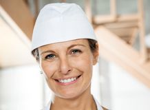 Beautiful Butcher Smiling In Butchery Royalty Free Stock Photo
