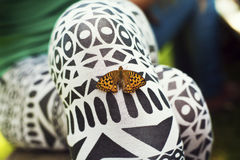 Beautiful butterfly sitting on the girl hand. Butterfly flew in and sat on the girl Royalty Free Stock Photo