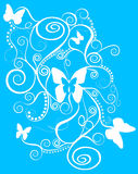 Beautiful butterfly spirals. An abstract design of butterflies, spirals and swirls in white on a blue background Royalty Free Stock Photography