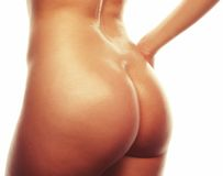 Beautiful buttocks of a nude woman Stock Images