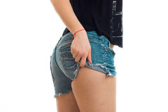 Beautiful buttocks of a young girl in denim shorts Stock Photography