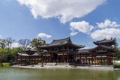The beautiful Byodo-in temple in Uji, Kyoto, Japan, on a beautiful sunny day with some clouds. The beautiful Byodo-in temple in Uji, Kyoto, Japan, Asia, on a stock photo