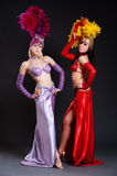 Beautiful cabaret women in bright costumes Stock Images