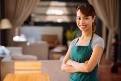 Beautiful cafe owner. Portrait of young beautiful Asian cafe owner Royalty Free Stock Images