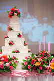 Beautiful Cake decorate with pink rose, flower and candle for Wedding Ceremony Stock Photos