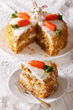 Beautiful cake decorated with bunny and carrot and slice close-u Royalty Free Stock Photo
