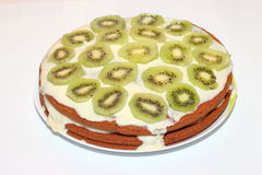 Beautiful cake with kiwi and bananas. On the table. Tea Party Stock Image