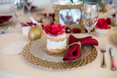 Beautiful cake on a plate on festive table Royalty Free Stock Images