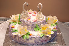 Beautiful cake for wedding with figures of swans Royalty Free Stock Photos