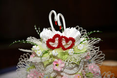 Beautiful cake for wedding with figures of swans closeup Royalty Free Stock Photos